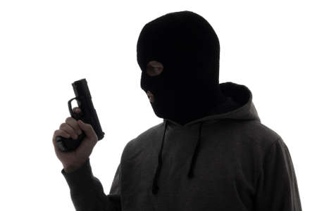 assasin: silhouette of criminal man in mask holding gun isolated on white background