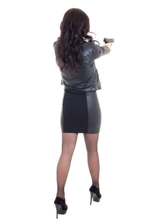 holding back: back view of woman shooting with gun isolated on white background