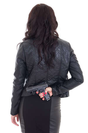 оружие: женщина прячется пистолет за спиной, изолированных на белом фоне Фото со стока