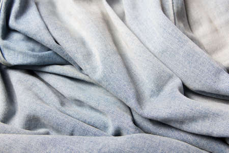 cotton  jeans: texture background - close up of wrinkled blue jeans material