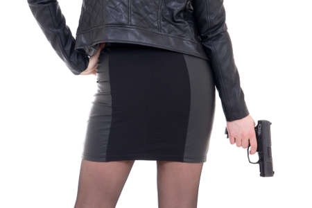 sexy woman with gun isolated on white background photo