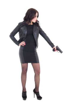 mujer con pistola: Mujer en arma celebraci�n de negro sobre fondo blanco Foto de archivo