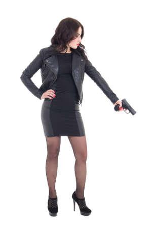 holding gun: woman in black holding gun isolated on white background Stock Photo