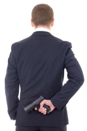 personas de espalda: hombre en traje de negocios que oculta la pistola detr�s de su espalda aislado en fondo blanco