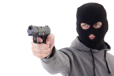 assasin: man in mask aiming with gun isolated on white background Stock Photo