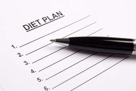 weightloss plan: sheet of paper with diet plan and pen