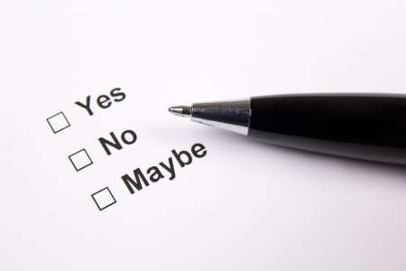 yes or no: survey with yes, no, maybe answers and metal pen Stock Photo