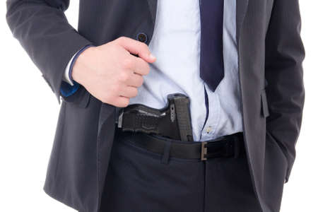 gun in policeman or bodyguard pants isolated on white background