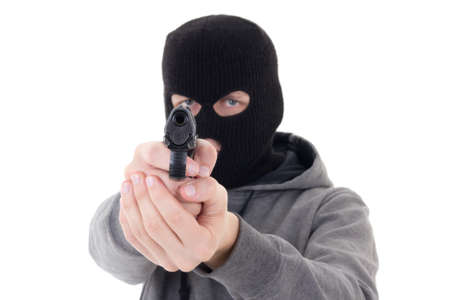 assasin: burglar or terrorist in mask shooting with gun isolated on white background Stock Photo