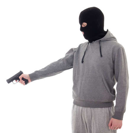assasin: profile view of man in black mask aiming with gun isolated on white background