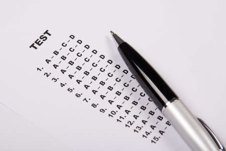 test score sheet with answers and metal pen photo
