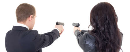 back view of man and woman shooting with guns isolated on white background Stock Photo