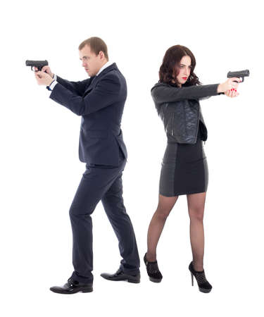 full length portrait of woman and man shooting with guns isolated on white background Stock Photo