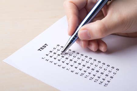 woman filling test score sheet with answers Reklamní fotografie - 38380167