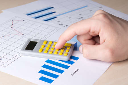 analyzed: business concept - close up of graphs and charts analyzed by accountant Stock Photo