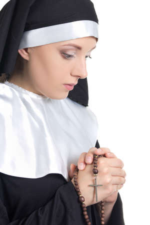 portrait of young beautiful woman nun with rosary isolated on white background photo