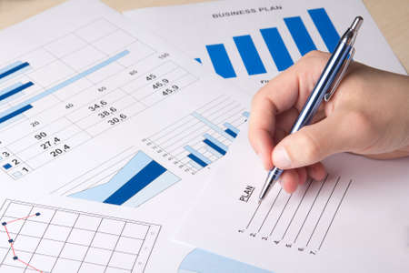 analyzed: close up of graphs and charts analyzed by businessman