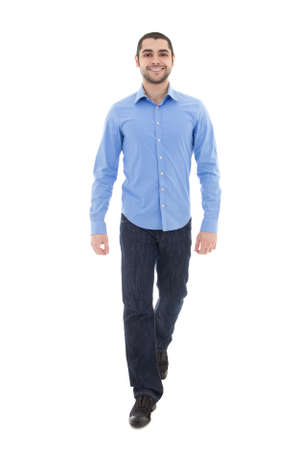 young arabic bearded business man in blue shirt walking isolated on white background Foto de archivo