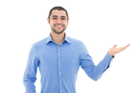 handsome arabic business man in blue shirt pointing at something isolated on white background photo