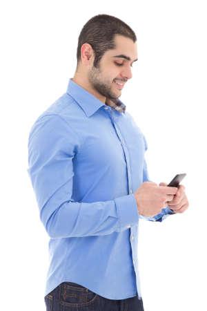 hombre arabe: Hombre árabe guapo con teléfono inteligente aisladas sobre fondo blanco Foto de archivo