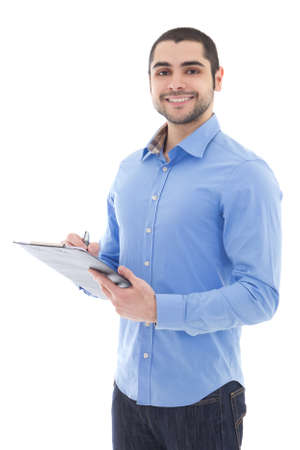 young arabic man writing something on clipboard isolated on white background Stockfoto