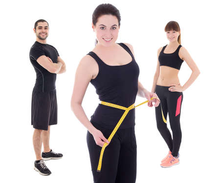 sports wear: weight loss concept - young people in sports wear isolated on white background