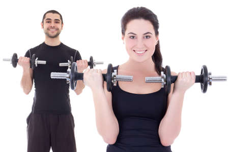 young attractive woman and man doing exercises with dumbbells isolated on white background photo