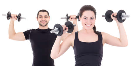 young man and woman in black sportswear doing exercises with dumbbells isolated on white background photo
