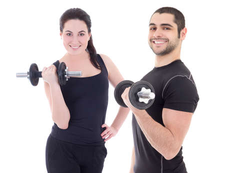 happy man and woman in sportswear doing exercises with dumbbells isolated on white background photo