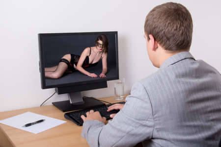 man looking adult content on computer in bright office