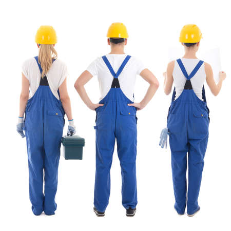 back view of man and two women in builders uniform isolated on white background photo