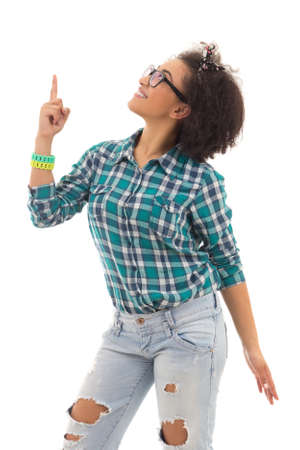 teenage girl: happy african american teenage girl pointing on something isolated on white background