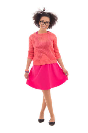 pink posing: beautiful african american teenage girl in pink posing isolated on white background