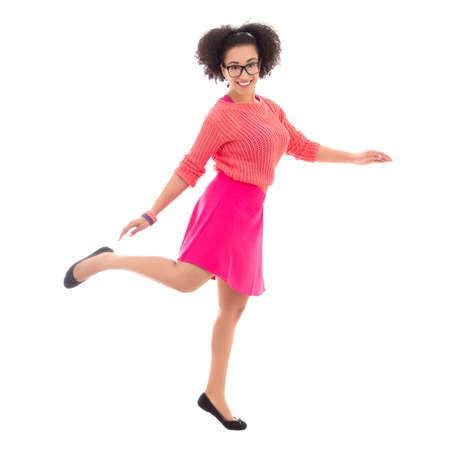 pink posing: happy african american teenage girl in pink posing isolated on white background Stock Photo
