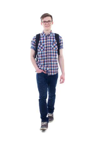 niño con mochila: vista frontal de adolescente guapo con mochila caminando aislados sobre fondo blanco Foto de archivo
