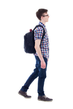 from side: handsome teenage boy with backpack walking isolated on white background