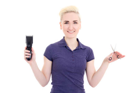 hair stylist: happy beautiful woman hair stylist with hair trimmer and scissors isolated on white background Stock Photo