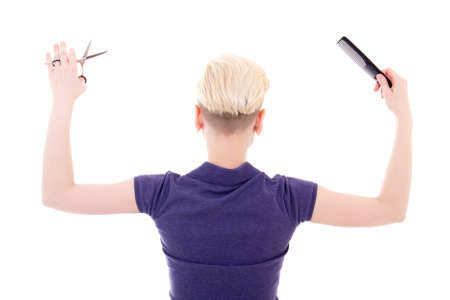 hair stylist: back view of woman hair stylist posing with comb and scissors isolated on white background