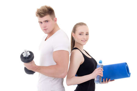 portrait of man and woman in sportswear with dumbbells and yoga mat isolated on white background photo