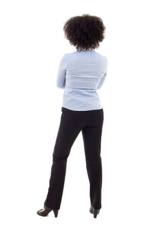 portrait view: back view of young african american business woman posing isolated on white background