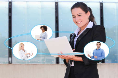 international internet: international business and internet concept - young business woman talking with her business partners in laptop Stock Photo