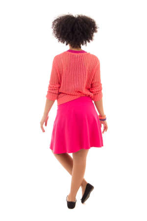 pink posing: back view of african american teenage girl in pink posing isolated on white background