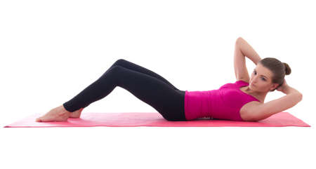 abdominal muscles: woman doing exercises for abdominal muscles isolated on white background