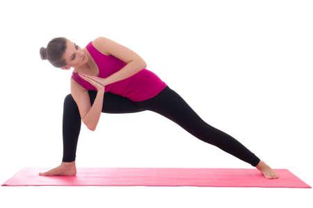 parsvakonasana: beautiful slim woman standing on pink mat in yoga pose isolated on white background