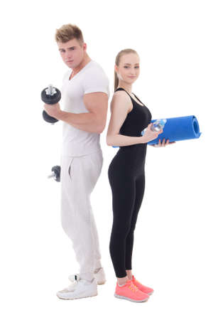 man and woman in sportswear with dumbbells and yoga mat isolated on white background photo