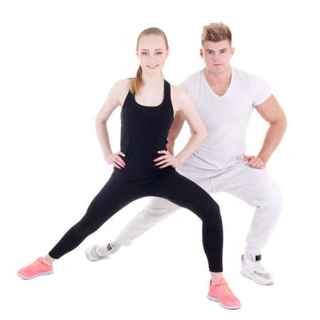 personal trainer: sporty man and woman stretching isolated on white background Stock Photo