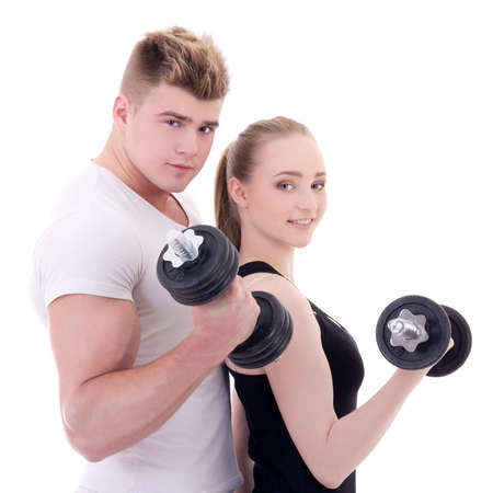 portrait of man and woman in sportswear doing exercises with dumbbells isolated on white background photo