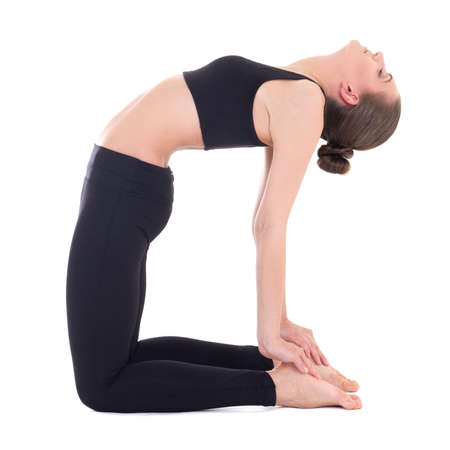 ushtrasana: yoga - young beautiful woman in camel pose isolated on white background