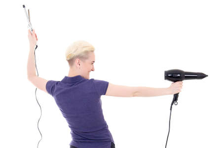back view of woman hair stylist posing with hairdryer and curler isolated on white background photo