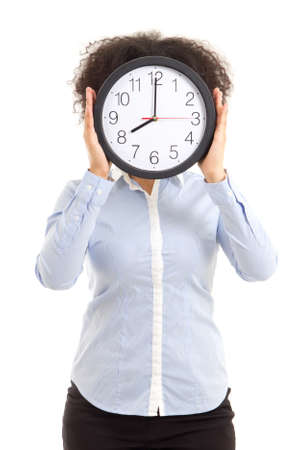 covering the face: woman covering face with office clock isolated on white background Stock Photo